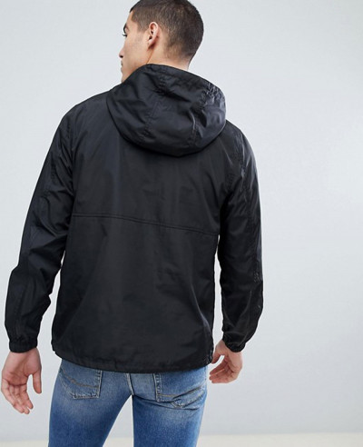 Design Overhead In Black Windbreaker Jacket